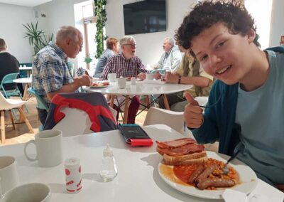Leo enjoying his cooked breakfast at the recent Men's Breakfast event at Church